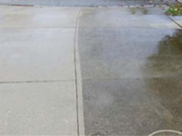 Concrete Pressure Washing example showing the difference between the unwashed and washed sections of concrete