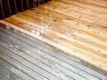 Deck cleaning showing the difference between wood that has been cleaned against wood that hasn't