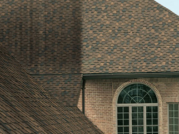 No pressure roof cleaning extends the life of your shingles and leaving you roof looking new again